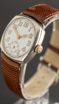 Early 1920s men's silver cushion watch. 32 mm case. Good timekeeper