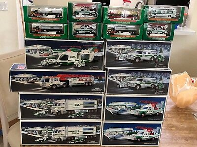 Hess Trucks 17 Total, Lot Of 8 Lg Trucks, 8 Miniatures, And A Mobile Toy Truck