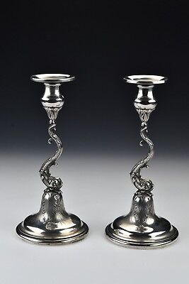 Pair of Spaulding & Co. Sterling Silver Figural Dolphin Candle Sticks