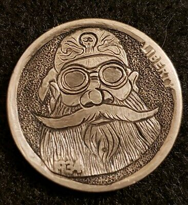 """1934 hobo nickel.  """"Marked Biker"""" hand carved and signed by Barb Hunter."""