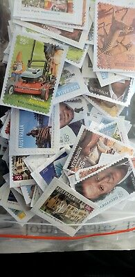 Unfranked 55 Cent Australian stamps. ON PAPER. FV $100.