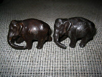 Antique or Vintage nicely modelled pair of metal elephants with a bronze patina