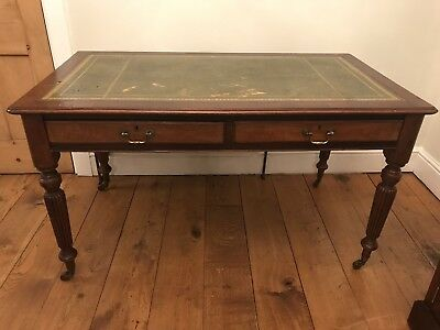 mahogany Victorian antique desk- green leather top - legs on wheels
