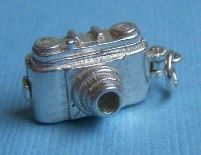 Vintage movable English movie camera opens to birdie sterling charm