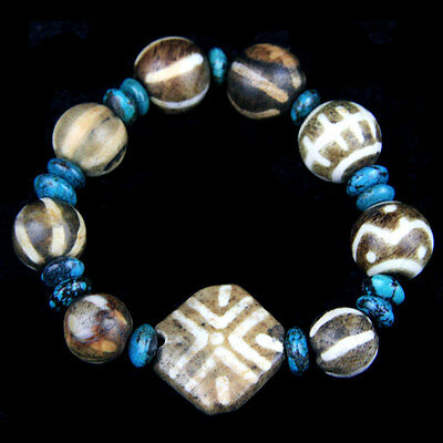 A bracelet comprising Himalayan turquoise discoid beads and Pumtek beads. y1040