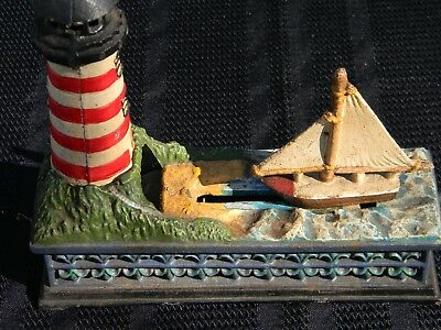 Cast Iron Mechanical Lighthouse Bank With Sail Boat Works Great