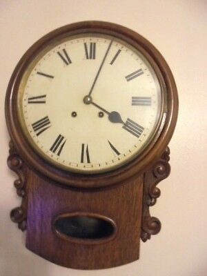 antique wall clock drop dial in an oak case