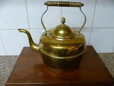 A Vintage French Brass Kettle. A Vintage French Brass Stove Top Kettle.