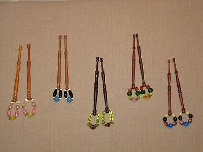 Selection of timber lace bobbins spangled with glass beads