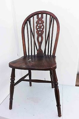 set of four wheelback elm seated chairs