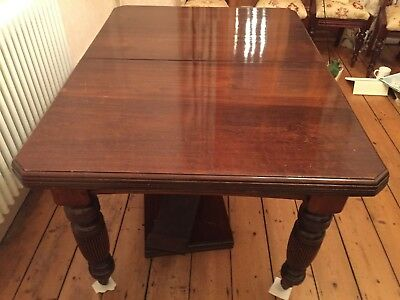 Victorian wind out mahogany dining table, with reeded legs