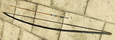 Old bow and arrow from New Guinea Highlands