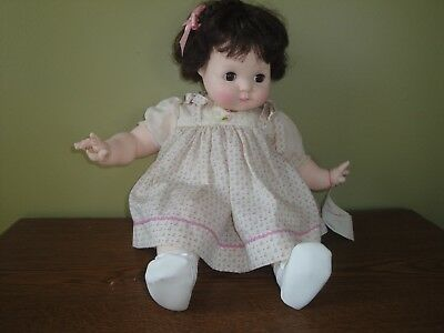"Madame Alexander ""Puddin"" baby doll, 1965, brunette with pink and white dress"