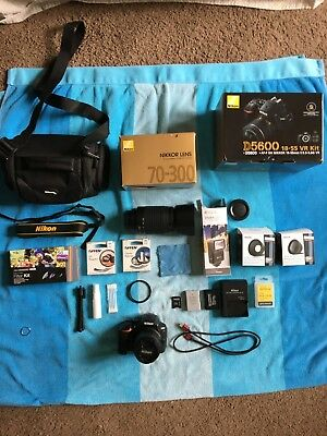 Nikon D5600 DSLR  24.2 MP Bundle 18-55mm and 70-300mm Lenses 64GB and more