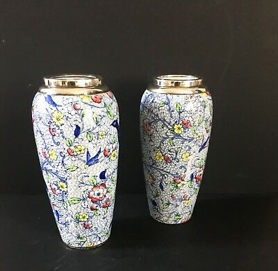 A pair of silver-mounted Art Deco vases.
