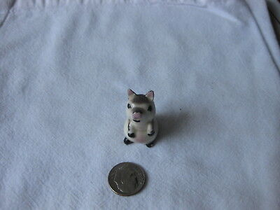 "Brown & Beige Sitting Up Pig, tiny, about 1"" tall"
