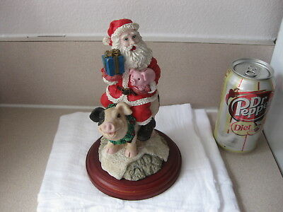 Santa on a Pig with Piggy Bank in Hand