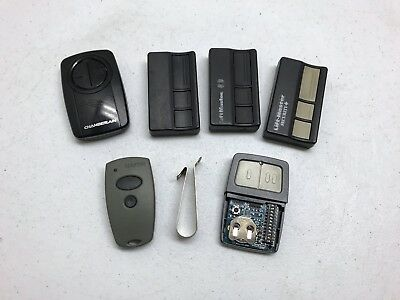 Garage Door Opener Remotes Chamberlain/ genie/ ect With Clips Used (lot of 3)