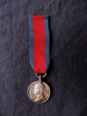 Original silver miniature Waterloo medal with correct suspension and silk ribbon