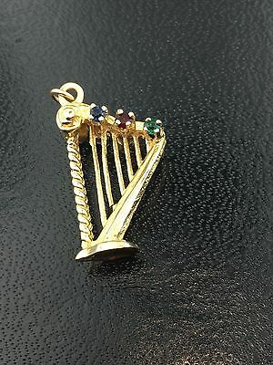 Vintage 14k yellow gold harp charm with synthetic stones