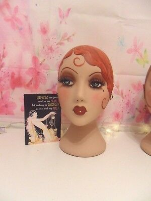 Vintage style hand painted mannequin head.