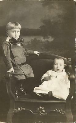 RPPC GIRL & Boy Sitting In Chair, Big Bow ANTIQUE REAL PHOTO POSTCARD