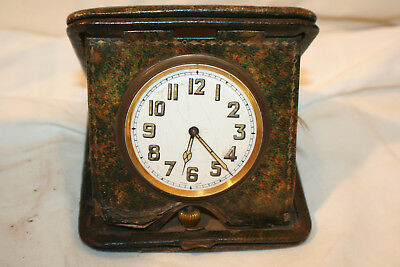 Art deco travelling clock in fitted leather case