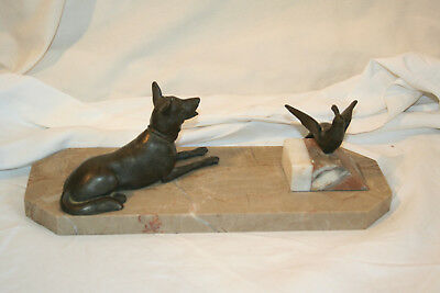 Art deco spelter and marble dog and bird ornament.