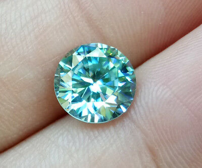2.35ct. 9mm. 100% REAL BLUE MOISSANITE ROUND BRILLIANT CUT TOP FIRE! CLEAN!!