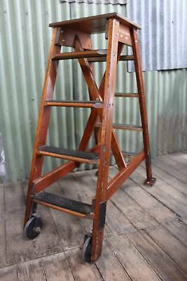 A Vintage Fixed A Frame Industrial Step Ladder on Wheels - Library Steps