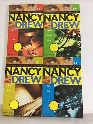 4 Nancy Drew Paperback Books