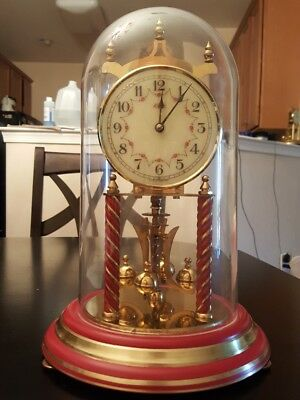 VINTAGE KUNDO ANNIVERSARY CLOCK  colonial red base and red twisted pilars very r