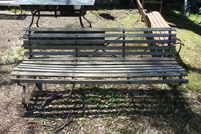 A Vintage Outdoor Garden Slatted Bench Seat on Metal Base