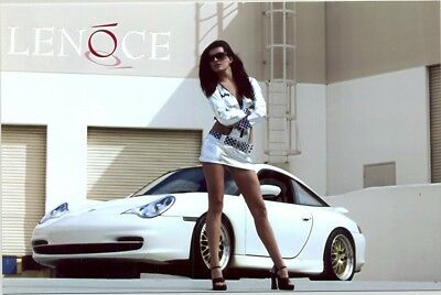 Danica Patrick  - Standing In Front Of A Sports Car With White Mini Dress