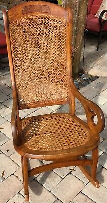 Antique American Walnut Rocking Chair caned seat & back