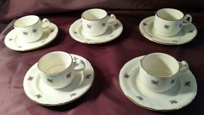 Five Royal Vale white demi-tasse cups and saucers -Thistle motif and gold rims.