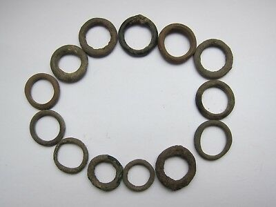 lot of 13 Celtic bronze ring-money,5th-1st cent BC. 2