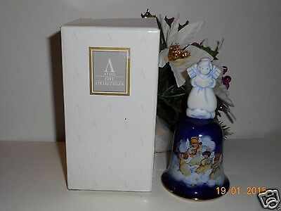 "1992 Avon Porcelain Christmas Bell called ""Heavenly Notes"""