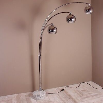 A Large Three Armed Chrome Floor lamp With Marble Base