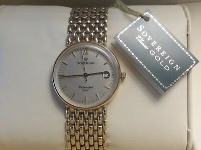 Brand new 9ct gold men's watch with 9ct gold wide bracelet and all tags still on