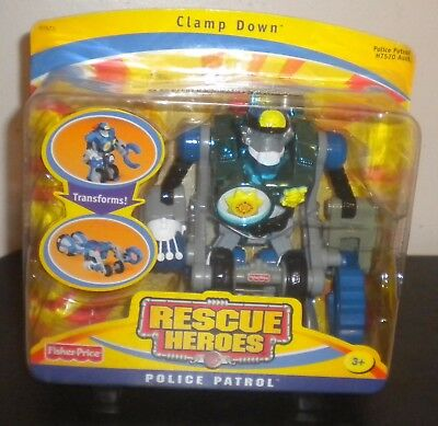 NEW 2005h FISHER PRICE RESCUE HEROES CLAMP DOWN POLICE OFFICER PATROL