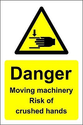 Moving machinery risk of crushed hands Danger safety sign