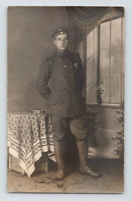 Antique WW1 GERMAN Real Photo RPPC Postcard HANDSOME SOLDIER in Uniform & MEDALS
