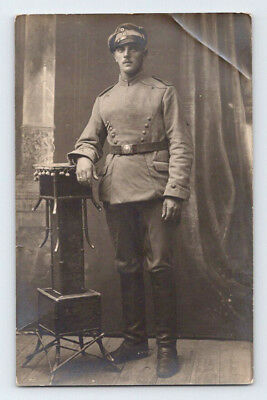 Antique WW1 GERMAN Real Photo RPPC Postcard HANDSOME SOLDIER in Uniform & Hat