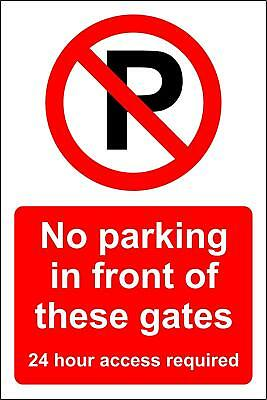 No parking in front of these gates 24 hour access required safety sign