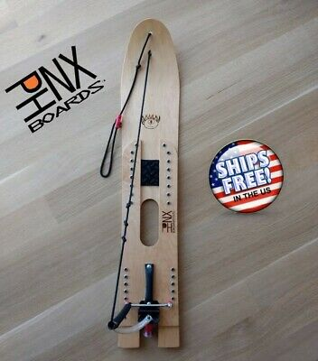 PHNX Boards re-invents the snurfer snowboard with an integrated binding/brake!