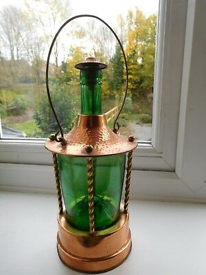Vintage decanter 1950s-60s beaten copper & etched green glass musical box base