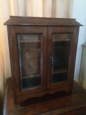 Oak Smokers Cabinet With Bevelled Glass