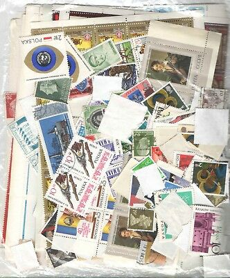 100 gram mixture of off-paper worldwide common stamps