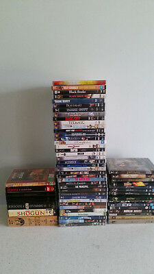 Bulk Lot of Used DVD's plus bonus portable DVD player